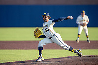 Michigan Wolverines pitcher Angelo Smith (40) delivers a pitch to the plate against the Michigan State Spartans on March 21, 2021 in NCAA baseball action at Ray Fisher Stadium in Ann Arbor, Michigan. Michigan scored 8 runs in the bottom of the ninth inning to defeat the Spartans 8-7. (Andrew Woolley/Four Seam Images)