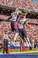 12 October 2014: New England Patriots wide receiver Brandon LaFell (19) and fullback James Develin (46) celebrate a touchdown against the Buffalo Bills at Ralph Wilson Stadium in Orchard Park, NY. The Patriots defeated the Bills 37-22 to move into first place in the AFC Eastern Division. Mandatory Credit: Ed Wolfstein Photo *** RAW (NEF) Image File Available ***
