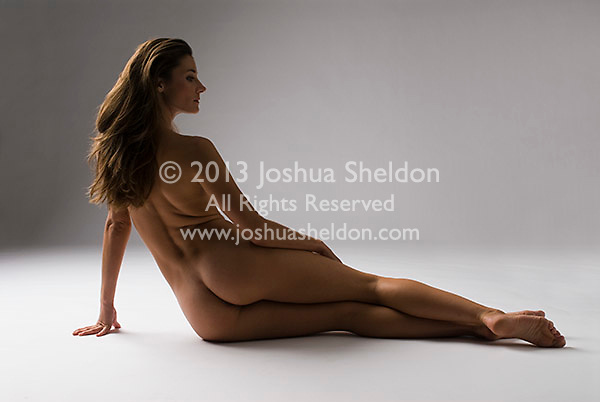 Nude woman reclining, rear view
