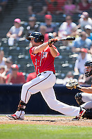 Mitch Delfino (10) of the Richmond Flying Squirrels follows through on his swing against the Bowie Baysox at The Diamond on May 24, 2015 in Richmond, Virginia.  The Flying Squirrels defeated the Baysox 5-2.  (Brian Westerholt/Four Seam Images)