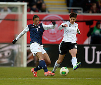 Offenbach, Germany, Friday, April 05 2013: Womans, Germany vs. USA, in the Stadium in Offenbach,  Shannon Boxx (USA) Linda Bresonik (GER)..