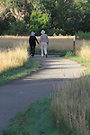 Senior couple walking on pathway, Boylder, Colorado, .  John leads private photo tours in Boulder and throughout Colorado. Year-round. .  John offers private photo tours in Denver, Boulder and throughout Colorado. Year-round Colorado photo tours.