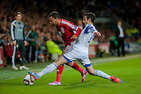 Wednesday 4th  December 2013 Pictured: Hal Robson-Kanu of Wales is tackles by Marios Nikolaou of Cyprus <br /> Re: UEFA European Championship Wales v Cyprus at the Cardiff City Stadium, Cardiff, Wales, UK