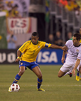 Brazil forward Robinho (7) controls the ball and fends off USA defender Carlos Bocanegra (3). Brazil  defeated the US men's national team, 2-0, in a friendly at Meadowlands Stadium on August 10, 2010.