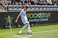 LOS ANGELES, CA - MAY 29: Eduard Atuesta #20of the LAFC takes a corner kick during a game between New York City FC and Los Angeles FC at Banc of California Stadium on May 29, 2021 in Los Angeles, California.