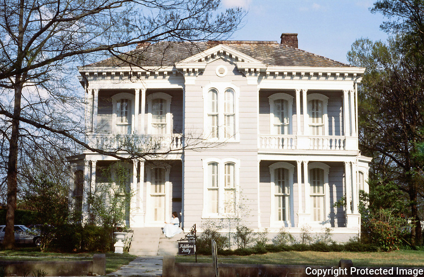 """Oxford:  """" Fiddler's Folly"""", 1878. 520 North Lamar,  an Italianate house designed by architect James Stewart for attorney Charles Howry was built out of pre-cut materials shipped by boat and assembled on site.  Later owners with an impressive violin collection named it """"Fiddler's Folly""""."""