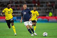 ORLANDO, FL - JULY 20: David Guzman #20 of Costa Rica kicks the ball during a game between Costa Rica and Jamaica at Exploria Stadium on July 20, 2021 in Orlando, Florida.