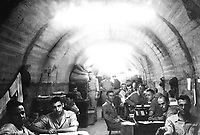 During the siege of Corregidor, P.I., the Finance Office, U.S. Army, Manila, shared lateral No. 12 of Melinta Tunnel with the Signal Corps. Members of the Finance Office staff appear in the foreground.  Ca. March/April 1942.  Maj. Paul Wing. (Army)  <br /> Exact Date Shot Unknown<br /> NARA FILE #:  111-SC-249636<br /> WAR & CONFLICT BOOK #:  1141
