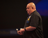 20.12.2014.  London, England.  William Hill World Darts Championship.  Andy Smith (28) [ENG] in action during his game with Ronny Huybrechts [BEL].