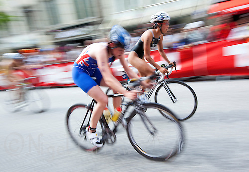 17 JUL 2011 - HAMBURG, GER - Lucy Hall (GBR) cycles through the spectator lined streets of Hamburg during the women's round of triathlon's ITU World Championship Series .(PHOTO (C) NIGEL FARROW)