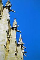Gargoyles atop vertical pier buttresses of Sainte-Chapelle. Paris France