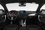 Stock photo of straight dashboard view of a 2018 BMW 1 Series M Sport Ultimate 3 Door Hatchback