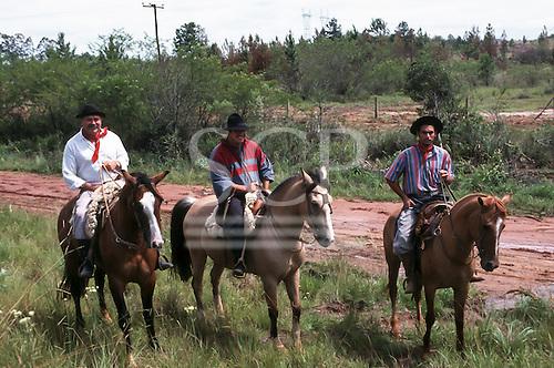 Serra do Gaucha, Rio Grande do Sul, Brazil. Three gaucho cowboys on horseback.