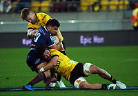 Hurricanes' Jordie Barrett (left) and Du'Plessis Kirifi tackle Reds' Hunter Paisami during the Super Rugby Tran-Tasman match between the Hurricanes and Reds at Sky Stadium in Wellington, New Zealand on Friday, 11 June 2020. Photo: Dave Lintott / lintottphoto.co.nz