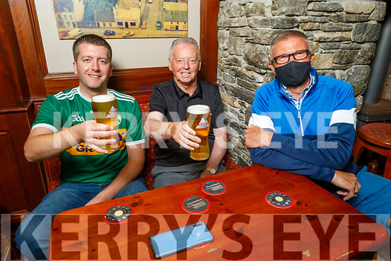 Gavin Griffin and Dominic Foley receive table service from Gerard O'Sullivan in the Castle Bar on their reopening on Monday. L to r: Gavin Griffin, Dominic Foley and Gerard O'Sullivan.