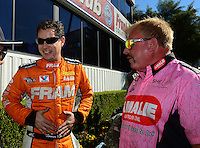 Nov. 11, 2012; Pomona, CA, USA: NHRA top fuel dragster driver Spencer Massey (left) and Terry McMillen during the Auto Club Finals at at Auto Club Raceway at Pomona. Mandatory Credit: Mark J. Rebilas-