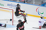 Sochi, RUSSIA - Mar 9 2014 -  Dominic Larocque celebrates a goal by Anthony Gale during Canada vs. Norway at the 2014 Paralympic Winter Games in Sochi, Russia.  (Photo: Matthew Murnaghan/Canadian Paralympic Committee)