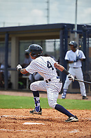 GCL Yankees West second baseman Borinquen Mendez (4) follows through on a swing during the second game of a doubleheader against the GCL Yankees East on July 19, 2017 at the Yankees Minor League Complex in Tampa, Florida.  GCL Yankees West defeated the GCL Yankees East 3-1.  (Mike Janes/Four Seam Images)