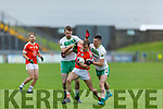 Timmy Finnegan of Brosna been bottled up by  Ballydonoghue's Jack Gogarty and Kevin O'Donnell in the Premier Junior Football Championship Semi-Final