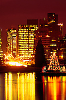 "Vancouver, BC, British Columbia, Canada - Christmas Tree Lights and Downtown ""West End"" Office Building Lights reflecting in ""Lost Lagoon"", Stanley Park"
