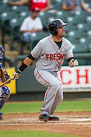 Fresno Grizzlies outfielder Travis Ishikawa (16) follows through on his swing during the Pacific Coast League baseball game against the Round Rock Express on June 22, 2014 at the Dell Diamond in Round Rock, Texas. The Express defeated the Grizzlies 2-1. (Andrew Woolley/Four Seam Images)
