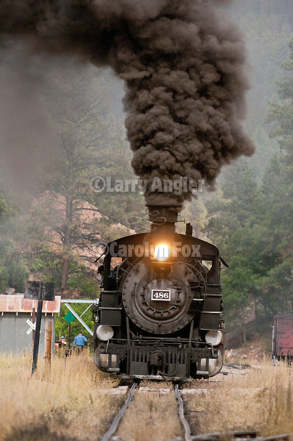 Durango and Silverton Narrow Gauge Railroad 1925 Baldwin K-36 No. 486 locomotive pauses for a whistle stop at the Rockwood station