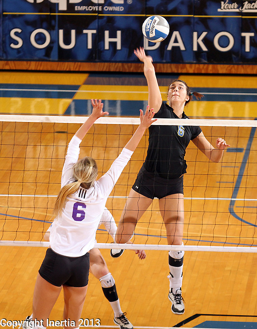 BROOKINGS, SD - NOVEMBER 9:  Courtney Roberts #6 from South Dakota State University tips the ball past Ann Miller #6 from Western Illinois in the second game of their match Saturday at Frost Arena. (Photo by Dave Eggen/Inertia)