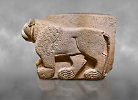 "Hittite relief sculpted stone panel. Lion. Aslantepe Gate Limestone, Aslantepe, Malatya, 1200-700 B.C. Anatolian Civilisations Museum, Ankara, Turkey.<br /> <br /> The lion on the left of the two lions at the gate of the palace. His head and his front part were processed as high embossing and his body as regular embossing. The signs behind the lion and over his tail read; ""Halposulupis, Mighty (?) King"".<br /> <br /> Against a grey art background."