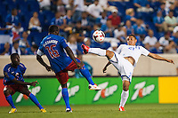 Honduras forward Roger Rojas (21) and Haiti midfielder Jean-Marc Alexandre (16). Honduras defeated Haiti 2-0 during a CONCACAF Gold Cup group B match at Red Bull Arena in Harrison, NJ, on July 8, 2013.