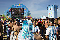 Argentina fans celebrate as they watch the big screen at the FIFA Fan Fest on Copacabana beach in Rio de Janeiro