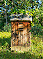 Old wooden outhouse.