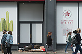 Homeless man sleeping in dooreway of closed Pret a Manger store, Oxford Street, London.