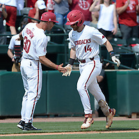 Arkansas first baseman Cullen Smith (14) is congratulated by assistant coach Nate Thompson Friday, June 4, 2021, after hitting a solo home run during the fourth inning of the Razorbacks' 13-8 win over New Jersey Institute of Technology in the first game of the NCAA Fayetteville Regional at Baum-Walker Stadium in Fayetteville. Visit nwaonline.com/210605Daily/ for today's photo gallery.<br /> (NWA Democrat-Gazette/Andy Shupe)