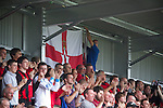 Crusaders 1 Fulham 3, 16/07/2011. Seaview Park, Europa League 2nd qualifying round first leg. Crusaders supporters cheering their team on to the pitch at Seaview Park, Belfast before the Northern Irish club take on Fulham in a UEFA Europa League 2nd qualifying round, first leg match. The visitors from England won by 3 goals to 1 before a crowd of 3011. Photo by Colin McPherson.