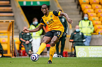 23rd May 2021; Molineux Stadium, Wolverhampton, West Midlands, England; English Premier League Football, Wolverhampton Wanderers versus Manchester United; Willy Boly of Wolverhampton Wanderers passes the ball out to the wing
