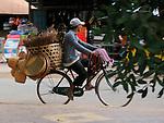 Man on Bike Selling Woven Goods, Cambodia