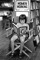 Tara MacNeil reading Wonder Woman at New Words Feminist Bookstore in Cambridge MA August 1976
