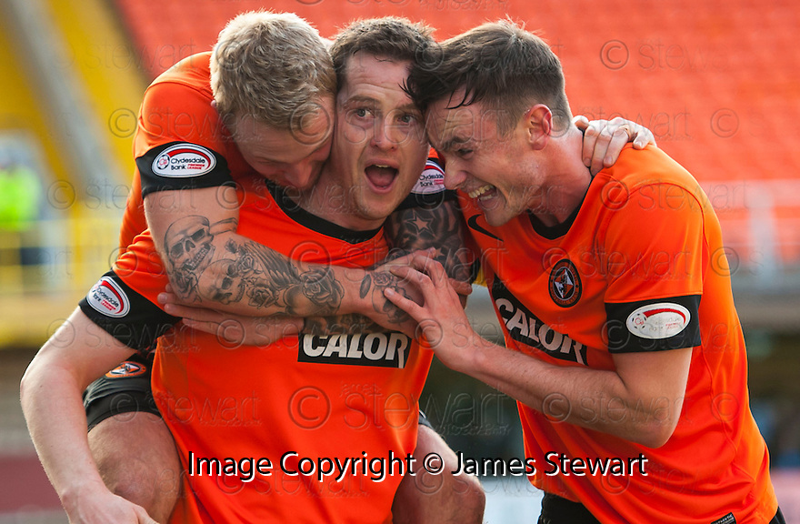 United's Jon Daly is congratulated by Johnny Russell and Keith Watson after he scores united's second.