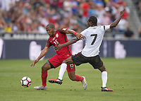 Commerce City, CO - Thursday June 08, 2017: Darlington Nagbe, Nathan Lewis during a 2018 FIFA World Cup Qualifying Final Round match between the men's national teams of the United States (USA) and Trinidad and Tobago (TRI) at Dick's Sporting Goods Park.
