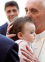 Papa Francesco saluta un bambino al termine dell'udienza generale del mercoledi' in Piazza San Pietro, Citta' del Vaticano, 19 giugno 2013.<br /> Pope Francis kisses a baby at the end of his weekly general audience in St. Peter's Square at the Vatican, 19 June 2013.<br /> UPDATE IMAGES PRESS/Riccardo De Luca<br /> <br /> STRICTLY ONLY FOR EDITORIAL USE