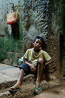 CAMBODIA 2007,SIAM REAP Boy resting inside the Preak Khan temple, near Angkor Wat