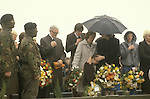 "Bobby Sands ""Robert Gerard Sands"" funeral  his mother in pale coat, wife Geraldine Noade with hands to head of their son Gerard who looks down. 1981 Milltown cemetery Northern Ireland 1980s UK"