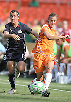 Lisa De Vanna #17 of Washington Freedom comes up behind Collette McCallum #14 of Sky Blue FC during a WPS match at RFK Stadium on May 23, 2009 in Washington D.C. Freedom won the match 2-1