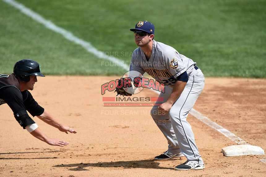 Burlington Bees first baseman Eric Aguilera (29) waits for a pick off attempt throw during a game against the Kane County Cougars on August 20, 2014 at Third Bank Ballpark in Geneva, Illinois.  Kane County defeated Burlington 7-3.  (Mike Janes/Four Seam Images)