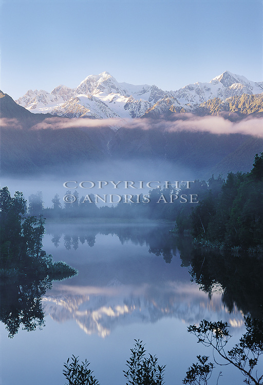 Lake Matheson and the Southern Alps reflected in Lake Matheson. Westland National Park. New Zealand. Vertical Format.