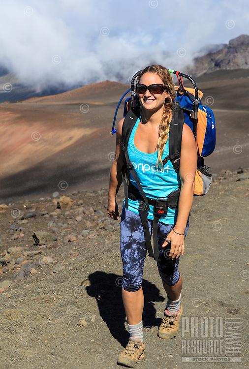 A backpacker walks the Sliding Sands Trail at Haleakala National Park, Maui.