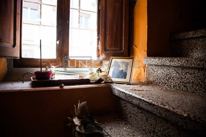 Inside the Red Zone, cordoning off the medieval center of L'Aquila. The interiors of the houses, fled on a deadly night of six years ago, still show the signs of an abruptly interrupted life.  L'Aquila, Italy. Apr. 10, 2015