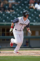 Zack Collins (8) of the Charlotte Knights starts down the first base line during the game against the Durham Bulls at BB&T BallPark on May 27, 2019 in Charlotte, North Carolina. The Bulls defeated the Knights 10-0. (Brian Westerholt/Four Seam Images)