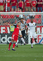 13 August 2011:Real Salt Lake midfielder Kyle Beckerman #5 and Toronto FC midfielder Eric Avila #8 in action during a game between Real Salt Lake and Toronto FC at BMO Field in Toronto.