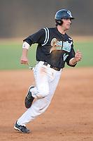 Tyler Bortnick #16 of the Coastal Carolina Chanticleers hustles into third base at Wake Forest Baseball Park April 8, 2009 in Winston-Salem, North Carolina. (Photo by Brian Westerholt / Four Seam Images)